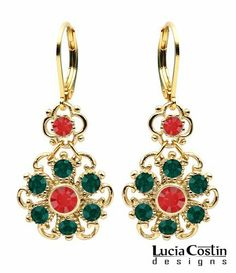 Lucia Costin 14K Yellow Gold Plated over .925 Sterling Silver Flower Shaped Dangle Earrings with Red, Green Swarovski Crystals, Dots, 4 Petal Flower and Twisted Lines Lucia Costin. $54.00. Produced delicately by hand, made in USA. Decorated with light siam and emerald - green Swarovski crystals. Unique and feminine, perfect to wear for special occasions and evenings. Feminine floral design. Dangle earrings by Lucia Costin