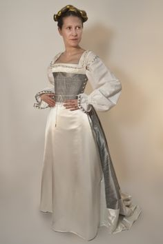 Tailor's - Hanka, Jane Seymour's Kirtle, part 1 Jane Seymour's Kirtle   There is a kirtle under the dress made of silver silk dupion, decorated w white silk satin + lined w linen. The kirtle consists of a bodice stiffened w sea-grass cords and decorated with a real pearls and gilded filigree beads around the neck, and the trained skirt. The bodice is laced on the sides with finger looped silk braids with a hand made brass point. The skirt is more stiffened in the front to hold better the…