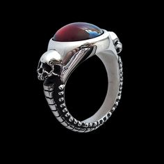 925 Solid Sterling Silver Skulls Ring Eternal Lovers with Red Garnet - Inspired by HR Giger artwork -  ALL SIZES by Silveralexa on Etsy https://www.etsy.com/listing/250577104/925-solid-sterling-silver-skulls-ring