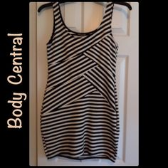 #17  BODY CENTRAL SLEEVELESS DRESS WOW!!  What a dress!!  Hugs the body just right.  Like new.  Black and white striped sleeveless dress.  Easy to care for.  Polyester/Rayon/Spandex Body Central Dresses