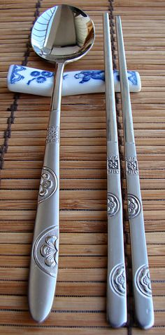 A stainless steel spoon (sutgarak, 숟가락) and a pair of stainless steel chopsticks (jeotgarak, 젓가락)
