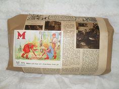anopin joululahjapaketoitu .... vanha kuvalehdensivu ja aapiskirjan kirjain M=mamma