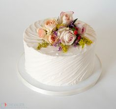 Textured buttercream cake with fresh flowers. Perfect for a small wedding, birthday or other special occasion.