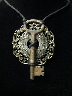 Love old keys & filligree jewelry both... lovely seeing them together. Great mixed-media piece!