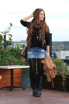jean skirt over tights w/ knee hight boots & a solid long sleeve top & printed scarf.