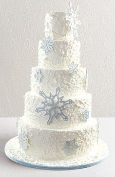 """winter wedding cake.. The cake is ugly, but the """"Winter Wedding"""" idea is something I regret not thinking of. I could have and should have had a Frostie Winter Wedding. It would have kicked ass. And the blue tux would have made more sense."""