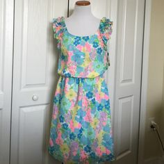 Summer Floral dress Beautiful summer floral print dress. Elastic waist and ruffle sleeve detail. Lilly Pulitzer Dresses Midi