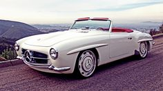 This, dear folks, is the Mercedes-Bent 190SL. Hot Rods and Custom Stuff gutted a 1961 Mercedes 190SL, then widened and lengthened the body to drop nicely on top of a 2004 Mercedes SL600 drive train sporting the 6.0L twin turbo 36 valve V-12 SOHC power plant. Then RENNTECH got a hold of it... the result is a beautiful white beast that runs 650 hp at 5500 rpm and 785 lb-ft of torque at 2000 rpm with digital ride height & locking slip differential.