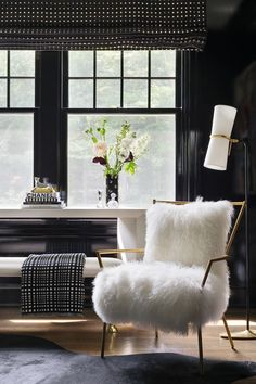 """""""Black is a bold but classic choice for winter decorating. Paired with warm fabrics like furs and velvets, a black room can create a luxurious retreat where you won't feel bad hibernating (and binge-watching Netflix) until spring.""""— Shelby Girard #blackdecor #blackpaint #blackdecor"""