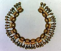 Mixtec  Turtleshell necklace,   A.D. late 15thearly 16th C.  Cast gold