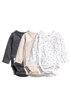 CONSCIOUS. Long-sleeved wrapover bodysuits in soft organic cotton jersey with press-studs at the side and crotch.
