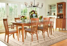 A traditional-style Classic Shaker dining room set perfect for any home. Solid cherry wood furniture handmade in Vermont.