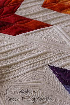 Kimberly Einmo's Fire & Ice quilted by Judi Madsen.