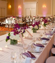 Classic look! White tables with purple napkins and dark wood chivari chairs.