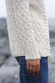 """A hand knit sweater and jeans. """"Fashion"""" doesn't get any better than that."""
