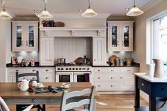 French Fancy - Kitchen Designs - Take your influence from across the water like this French-inspired ktichen with its chic ecru, navy and blue scheme and cool Parisian cafe lights. Kitchen from John Lewis of Hungerford