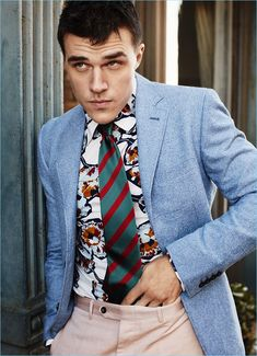 Finn Wittrock wears a Canali suit with a printed Marni shirt and Drake's tie.