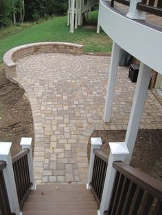 Paver patio (at bottom of deck stairs) Fire Pit Backyard, Backyard Patio, Backyard Landscaping, Pavers Patio, Patio With Firepit, Unilock Pavers, Garden Pavers, Raised Patio, Backyard Fireplace