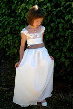 An ivory lace flower girl dress for a wedding. Custom Flower girls dress, birthday, special occasion dress.