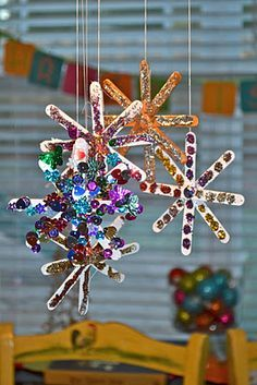 """Popsicle Snowflakes. Could use less """"girly"""" stuff like small pebbles, marbles, leaves, etc for Cub Scouts."""