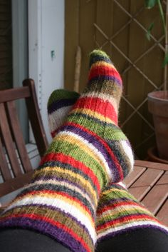 https://flic.kr/p/6P3MeT | Socks | Socks I made with the yarn left over from the Doctor Who scarf. The stripes are in the same order as on the scarf, only narrower.