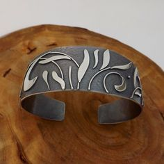 Cuff from a past series. The floral landscape series was when I really started to feel I was finding my style. It ultimately lead to the designs I'm creating today.