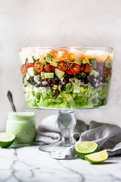 Mexican Shrimp Cobb Salad is a beautifully layered salad with shrimp, avocados, grilled corn, black bean salsa, cucumbers, tomatoes and cheese.