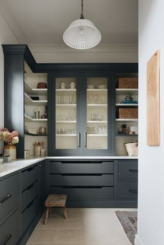 Kate Marker Interiors - Stoffer Photography - Black kitchen pantry cabinets with brass grille fronts are flanked by stacked white and black shelves and finished with black crown moldings. Kitchen Pantry Design, Kitchen Pantry Cabinets, Kitchen Interior, New Kitchen, Kitchen Storage, Kitchen Dining, Kitchen Decor, Kitchen Island, Kitchen Ideas
