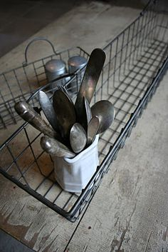 Antique flatware in metal basket