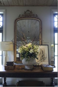 Miscellaneous - COTE DE TEXAS Foyer Decor compiled by a brass dainty mirror over a console table decked with frames, flowers and a lamp South Shore Decorating, Foyer Decorating, Interior Decorating, Interior Design, Decorating Ideas, Design Interiors, Decorating Websites, Modern Interior, French Decor