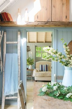 Linda Kilburn transformed the bottom of her garden and created a relaxed new living space when she built a charming summerhouse on the waterside – complete with rowing boat