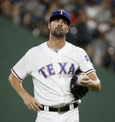 Texas Rangers starting pitcher Cole Hamels reacts during the 5th inning at Globe Life Park in Arlington, Texas, Thursday, July 28, 2016. (Jae S. Lee/The Dallas Morning News)