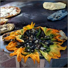 Flores de calabaza con huitlacoche (squash flowers with huitlacoche) I'd like a quesadilla, please.