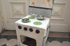 Chair cover turns a regular chair a stove for playtime! This is in German, but so adorable. @ldmartin4