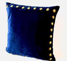Navy blue pillow in velvet with gold sequin detail. This navy blue passion pillow pillow a has a plush rich feel with the gold sequin all along the edges. Blue throw pillows makes a great add to your