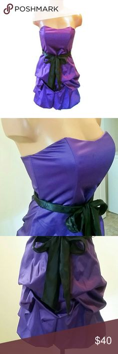 """Purple Party Dress Beautiful purple satiny dress with bubble skirt and black satin sash that ties at waist. It has a sweetheart neckline, zips up the back, and is fully lined. This is a junior's size 5 and has a very flattering fit. Would fit a women's size 4/6 or small, it is 27"""" long. I wore this once to a holiday party, it's in perfect condition and great for special occasions like weddings, proms, and cocktail parties. Dresses Strapless"""