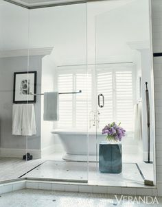 Seamless glass shower doors open up the space to create light and tranquility.