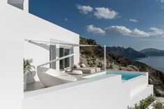 Saint Hotel on the coast of Santorini has rooms in white-painted caves The Saint, Hotel Sites, Smooth Walls, Massage Room, Building Structure, Restaurant, School Architecture, Lounge Areas, White Paints