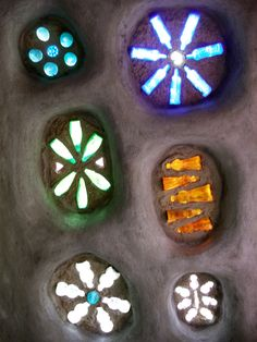"Stunning Glass Bottle Windows in Cob. Cob housing is the latest ""Earth friendly"" housing craze."