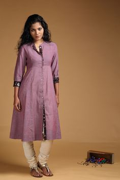 This muslin khadi kurta with dori checks in mulberry is darted at the waist & is offset with brown handblockprinted detail