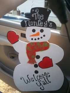 Whimsical Christmas Personalized Glittery Snowman Wooden Door Hanger. $30.00, via Etsy.