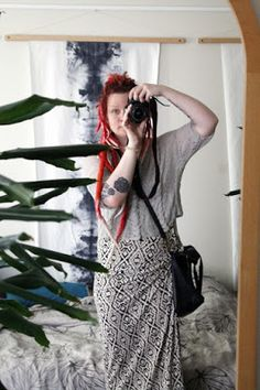 Martje: Red dreads and patterned dress