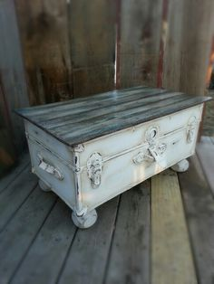 Upcycled steamer trunk turned into a coffee table with a pallet board top