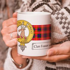 Ceramic coffee mug with clan crest - only from ScotClans. Solid mug with your chosen clan crest printed on using sublimation print. Printed by ScotClans in Edinburgh, Scotland. Pictured, Fraser of Lovat, Fraser.
