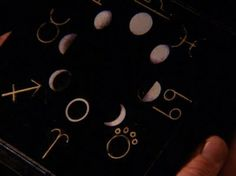 """TWIN PEAKS – EPISODES 18 & 19 - Pete: """"It's a puzzle box.""""  ...the creepy black box given to Catherine...is a puzzle box – one that's coded via a series of zodiac symbols and moon phases. ...Twin Peaks' mythology seems based, at least in part, on planets and on planetary alignments. Thus the zodiac and the phases of the moon. It's also based, to some extent, on alchemy, which counts seven """"planetary metals"""" among its elements, represented by zodiac symbology."""