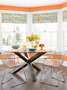 This dining room gets a vibrant pop of color from the orange walls and seat covers. More fresh dining room decorating ideas:  http://www.bhg.com/rooms/dining-room/themes/sleek-modern-dining-rooms/?socsrc=bhgpin082313orangewalls=17