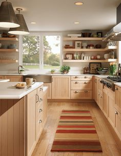 In Love with this Kitchen! Love the shelving units! Long rows of open shelving…