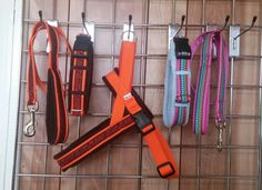 Left to right.  25mm all on orange webbing with 16mm Geared Up ribbon .. Standard Lead with fleece lined handle in brown fleece, Side Release Collar with brown fleece lining and Activity Harness in orange heavy webbing with fleece lined handle.  25mm Side Release Collar on Cerise cushioned webbing, Sky fleece lining and Indian Petal ribbon with a matching Standard Lead.
