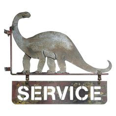 Very Early Dino Service Station Sign   From a unique collection of antique and modern signs at https://www.1stdibs.com/furniture/folk-art/signs/