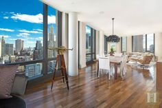 Luxury in the Sky   ....        Enjoy brilliant light and mesmerizing views from every room in this breathtaking high floor 3,800SF corner residence at 101 Warren Street - Tribeca's premier full-service luxury condominium! This extraordinary home features a loft-like Living/Dining room wrapped in glass with high ceilings, rich walnut flooring, and iconic views from endless floor-to-ceiling windows. See more at www.halstead.com/9685987
